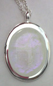 Click for a larger photo of the Clear Glass with a Hint of Pink on White Oval in Silver-plated Setting