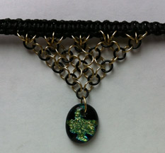 Click for a larger photo of the Clear Glass on Blue, Green & Gold Splatter Patterned Oval Shaped Chain Maille Choker