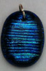 Click for a larger photo of the Clear Glass on Blue Horizontal Rib Patterned Oval Shaped Necklace