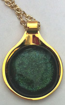 Click for a larger photo of the Clear Glass on Iridescent Green Round in Gold-plated Setting