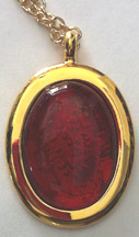 Click for a larger photo of the Clear Glass on Iridescent Red Oval in Gold-plated Setting