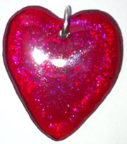 Click for a larger photo of the Clear Glass on Iridescent Red Heart Shaped Necklace